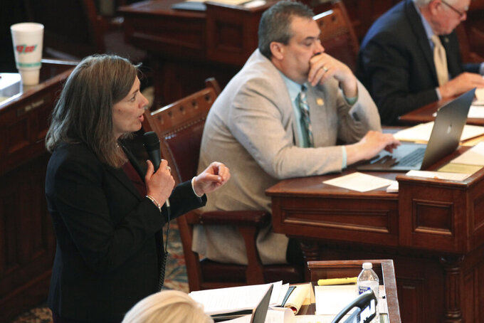 Kansas state Sen. Kellie Warren, R-Leawood, speaks during a Senate debate on legislation dealing with COVID-19, Tuesday, May 4, 2021, at the Statehouse in Topeka, Kan. Warren is the chair of the Senate Judiciary Committee and is pushing a proposal to set aside up to $2 billion in federal COVID-19 relief funds to compensate businesses hurt by the pandemic. (AP Photo/John Hanna)