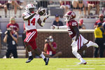 Nebraska running back Rahmir Johnson (14) catches a pass in front of Oklahoma defensive back Justin Broiles (25) in the first half of an NCAA college football game, Saturday, Sept. 18, 2021, in Norman, Okla. (AP Photo/Sue Ogrocki)