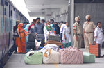 Passengers stand with their luggage after alighting from the Samjhauta Express, a train that runs between Delhi in India and Lahore in Pakistan, in Attari, a town along the border with Pakistan, in the northern Indian state of Punjab, Thursday, Aug. 8, 2019. Pakistan says it has suspended the key train service with neighboring India over change in Kashmir's special status by New Delhi. Federal Minister for Railways Sheikh Rashid Ahmad says the Samjhauta Express, or Friendship Express, train service is suspended from Thursday. (AP Photo/Prabhjot Gill)