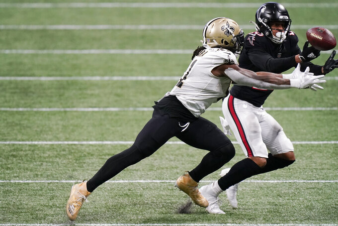 Atlanta Falcons cornerback Isaiah Oliver (26) makes the catch ahead of New Orleans Saints running back Alvin Kamara (41) during the second half of an NFL football game, Sunday, Dec. 6, 2020, in Atlanta. (AP Photo/Brynn Anderson)