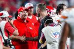 Kansas City Chiefs head coach Andy Reid, left, greets Arizona Cardinals head coach Kliff Kingsbury after an NFL football game, Friday, Aug. 20, 2021, in Glendale, Ariz. The Chiefs won 17-10. (AP Photo/Ross D. Franklin)