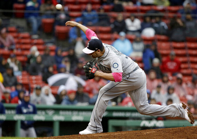 Seattle Mariners' Anthony Swarzak delivers a pitch against the Boston Red Sox during the sixth inning of a baseball game at Fenway Park, Sunday, May 12, 2019, in Boston. (AP Photo/Steven Senne)