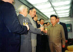 In this photo taken Aug. 15, 2001, North Korean leader Kim Jong Il, right, toasts with North Korean and Russian officials inside a train somewhere in Russia.  North Korean leader Kim Jong Un, like his father Kim Jong Il, is likely to travel by train to Vladivostok in Russia for a much-anticipated summit with Russian President Vladimir Putin on upcoming Thursday, a Kremlin adviser said, putting an end to weeks of speculation about when and where it would take place. (Georgy Toloraya via AP)