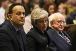 Ireland's Prime Minister Leo Varadkar, left, Britain's Prime Minister Theresa May and Irish President Michael D Higgins attend  the funeral of journalist Lyra McKee at St Anne's Cathedral in Belfast, northern Ireland, Wednesday April 24, 2019. The leaders of Britain and Ireland will join hundreds of mourners Wednesday at the funeral of Lyra McKee, the young journalist shot dead during rioting in Northern Ireland last week. (Brian Lawless/Pool via AP)