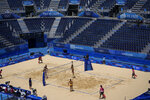Brazil play against Argentina at the empty Shiokaze Park during a women's beach volleyball match at the 2020 Summer Olympics, Saturday, July 24, 2021, in Tokyo, Japan. (AP Photo/Petros Giannakouris)