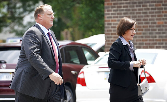 FILE - In this July 13, 2018 file photo, former Iowa Gov. Chet Culver and his wife Mariclare arrive at the First Christian Church for funeral services for former Iowa Gov. Bob Ray. Former Gov. Culver is President Joe Biden's choice to join the board of Farmer Mac, an organization that helps provide loans to farmers and ranchers and to rural utilities as well as providing USDA loan guarantees. (AP Photo/Charlie Neibergall File)