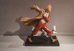 A 1988 polychrome resin sculpture of the comic character Tintin and his dog snowy from the 1941