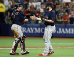 Boston Red Sox relief pitcher Ryan Brasier, right, and catcher Christian Vazquez celebrate after closing out the Tampa Bay Rays during the ninth inning of a baseball game Friday, April 19, 2019, in St. Petersburg, Fla. (AP Photo/Chris O'Meara)