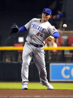 Chicago Cubs first baseman Anthony Rizzo makes a play for an out on a ball hit by Arizona Diamondbacks' Pavin Smith in the first inning during a baseball game, Saturday, July 17, 2021, in Phoenix. (AP Photo/Rick Scuteri)