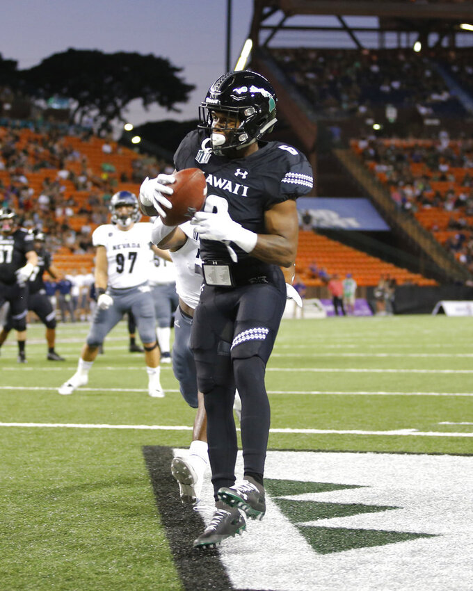 Hawaii wide receiver Cedric Byrd (6) pulls in a touchdown against Nevada during the first half of an NCAA college football game Saturday, Oct. 20, 2018, in Honolulu. (AP Photo/Marco Garcia)