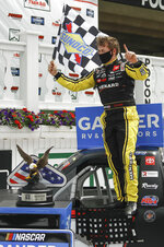 Brandon Jones celebrates after winning the NASCAR Truck Series auto race at Pocono Raceway, Sunday, June 28, 2020, in Long Pond, Pa. (AP Photo/Matt Slocum)