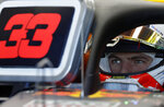Red Bull driver Max Verstappen of the Netherlands sits in his car during the first practice session of the Australian Grand Prix in Melbourne, Australia, Friday, March 15, 2019. The first race of the year is Sunday. (AP Photo/Rick Rycroft)