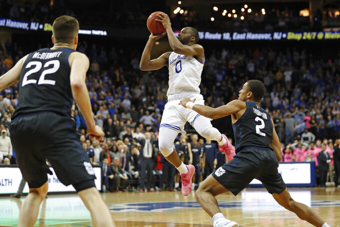 Seton Hall guard Quincy McKnight (0) goes up for a shot with Butler guard Aaron Thompson (2) defending and forward Sean McDermott (22) watching during the second half of an NCAA college basketball game Wednesday, Feb. 19, 2020, in Newark, N.J. (AP Photo/Kathy Willens)