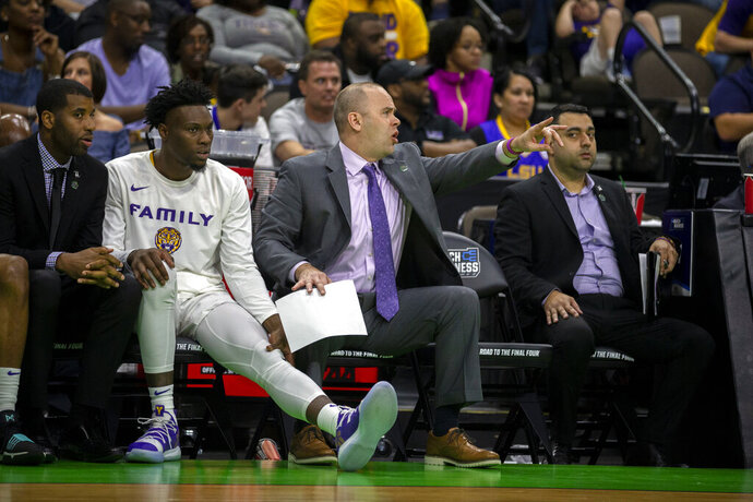 FILE - In this March 21, 2019, file photo, LSU assistant coach Bill Armstrong, center, coaches from the bench during the first half of a first round men's college basketball game against Yale in the NCAA Tournament in Jacksonville, Fla. LSU assistant coach Bill Armstrong and support staff member Kevin Nickelberry have been promoted after the LSU Board of Supervisors approved new contracts for the pair of Friday, June 19, 2020. (AP Photo/Stephen B. Morton, File)
