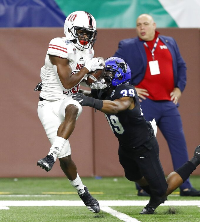 Northern Illinois wide receiver D.J. Brown (10), defended by Buffalo cornerback Cameron Lewis (39) catches a 8-yard pass for the go-ahead touchdown during the second half of the Mid-American Conference championship NCAA college football game, Friday, Nov. 30, 2018, in Detroit. (AP Photo/Carlos Osorio)