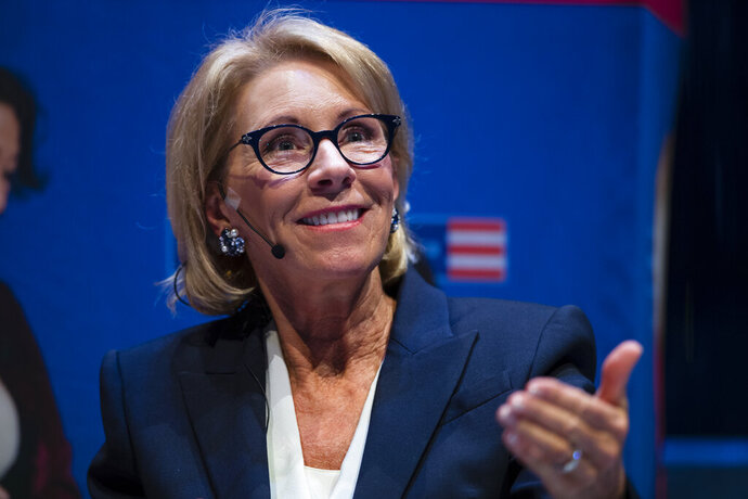 FILE - In this Sept. 17, 2018, file photo, Education Secretary Betsy DeVos speaks during a student town hall at the National Constitution Center in Philadelphia. One of the nation's largest teachers' unions sued the U.S. Education Department on Thursday, July 11, 2019, over a federal program that promises to forgive student loans for public workers but has been beset by problems. (AP Photo/Matt Rourke, File)