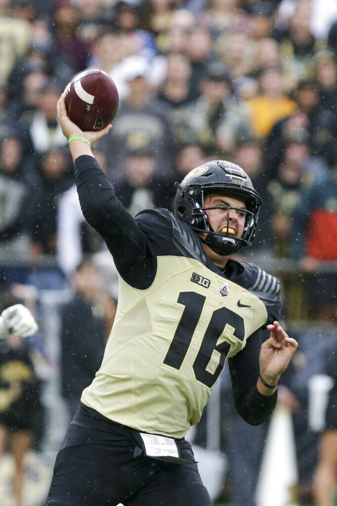 Purdue quarterback Aidan O'Connell (16) throws during the first quarter of an NCAA college football game, Saturday, Oct. 2, 2021, at Ross-Ade Stadium in West Lafayette, Ind. (Nikos Frazier/Journal & Courier via AP)