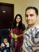 In this family photo, Kamran Arshad, his wife Iqra Kamran, and infant daughter Hiyam Kamran pose for a photograph in Dubai, United Arab Emirates, July 7, 2020. They are among the hundreds of thousands of foreign residents of the United Arab Emirates who now are stuck abroad amid the coronavirus pandemic. (Kamran Arshad via AP)