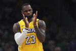 Los Angeles Lakers forward LeBron James applauds his teammates during the first half of an NBA basketball game against the Boston Celtics in Boston, Monday, Jan. 20, 2020. (AP Photo/Charles Krupa)