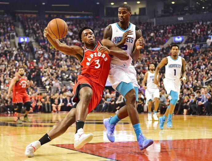 Toronto Raptors forward OG Anunoby (3) drives as Charlotte Hornets forward Marvin Williams (2) defends during first half NBA action in Toronto on Monday, Nov. 18, 2019. (Frank Gunn/The Canadian Press via AP)