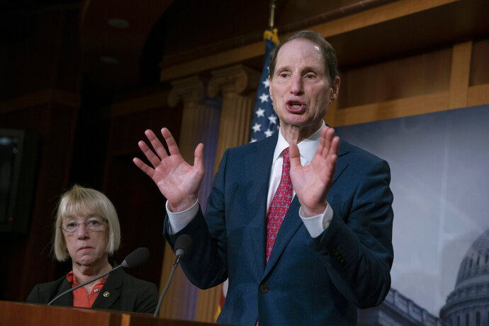 FILE - In this Dec. 19, 2018, file photo, Sen. Ron Wyden, D-Ore., joined at left by Sen. Patty Murray, D-Ore., speaks during a news conference to press Congress to intervene on behalf of the Affordable Care Act, after a federal judge in Texas ruled it unconstitutional, on Capitol Hill in Washington. Wyden has proposed legislation that would give states a free hand to allow legal marijuana markets without the threat of federal criminal intervention. (AP Photo/J. Scott Applewhite, File)