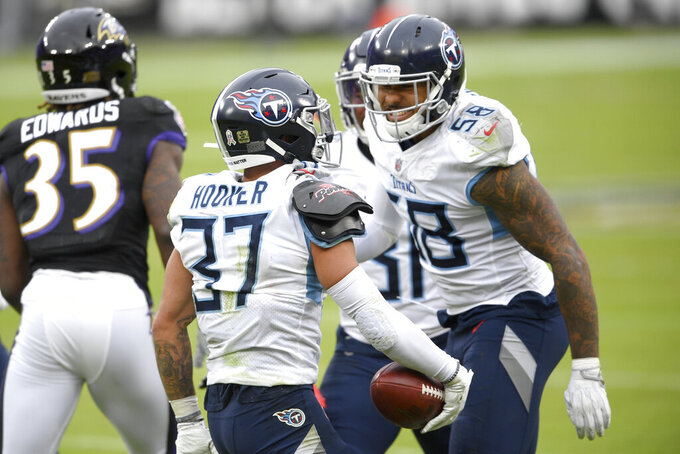 Tennessee Titans safety Amani Hooker (37) celebrates his interception with outside linebacker Harold Landry (58) during the second half of an NFL football game against the Baltimore Ravens, Sunday, Nov. 22, 2020, in Baltimore. (AP Photo/Nick Wass)