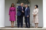 President Donald Trump and first lady Melania Trump pose for photographs with South Korean President Moon Jae-In and his wife Kim Jung-Sook outside the Oval Office of the White House, Thursday, April 11, 2019, in Washington. (AP Photo/Evan Vucci)