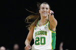 FILE - In this March 8, 2020, file photo, Oregon's Sabrina Ionescu (20) reacts after her team scored against Stanford during the second half of an NCAA college basketball game in the final of the Pac-12 women's tournament in Las Vegas. New York Liberty star Sabrina Ionescu is checking in periodically from the WNBA bubble at IMG Academy. She is offering her thoughts on her rookie season at the WNBA bubble as told to AP Basketball Writer Doug Feinberg. (AP Photo/John Locher, File)