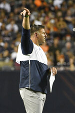 Tennessee Titans coach Mike Vrabel reacts to a call during the first half of the team's NFL preseason football game against the Chicago Bears, Thursday, Aug. 29, 2019, in Chicago. (AP Photo/David Banks)