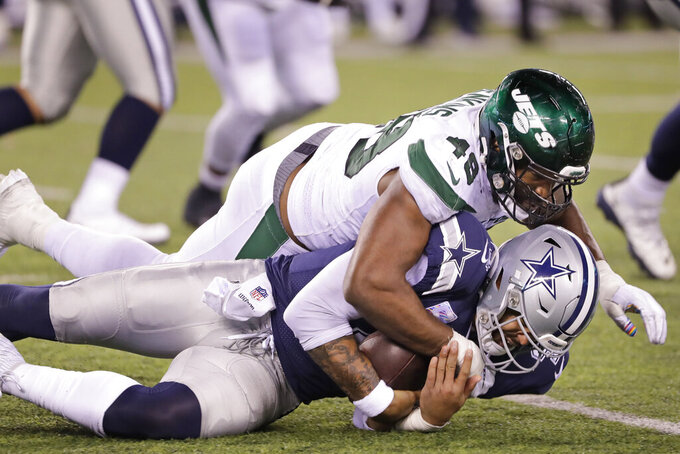 New York Jets' Jordan Jenkins, top, takes down Dallas Cowboys quarterback Dak Prescott during the second half of an NFL football game, Sunday, Oct. 13, 2019, in East Rutherford, N.J. The Jets defeated the Cowboys 24-22. (AP Photo/Frank Franklin II)