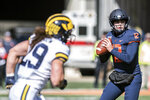 Illinois quarterback Matt Robinson (12) looks for an open receiver during the first half of an NCAA college football game against Michigan, Saturday, Oct. 12, 2019, in Champaign, Ill. (AP Photo/Holly Hart)