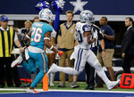 Dallas Cowboys running back Tony Pollard (20) gets past Miami Dolphins defensive back Steven Parker (26) into the end zone for a touchdown in the second half of an NFL football game in Arlington, Texas, Sunday, Sept. 22, 2019. (AP Photo/Michael Ainsworth)