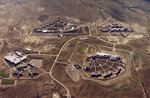 FILE - This Feb. 11, 2004, file photo provided by the Bureau of Prisons shows the Federal Correctional Complex in Florence, Colo. Clockwise from lower left is the minimum security Federal Prison Camp, the high security United States Penitentiary, the maximum security United States Penitentiary and the Federal Correctional Institution. Experts say the drug lord Joaquin