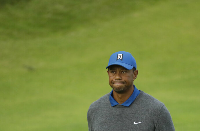 Tiger Woods of the United States looks up as he walks off the 18th green after completing his first round of the British Open Golf Championships at Royal Portrush in Northern Ireland, Thursday, July 18, 2019.(AP Photo/Matt Dunham)