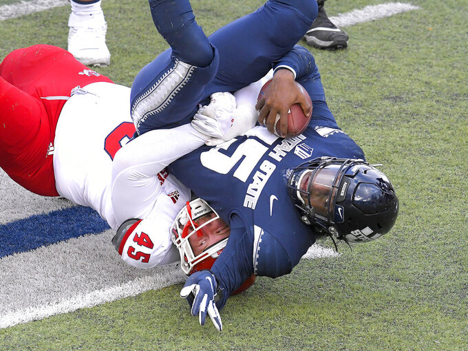 Fresno State defensive lineman Kurtis Brown (45) sacks Utah State quarterback Jason Shelley (15) during the first half of an NCAA college football game, Saturday, Nov. 14, 2020, in Logan, Utah. (Eli Lucero/Herald Journal via AP)