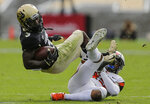 Colorado wide receiver K.D. Nixon (3) is tripped by Oregon State safety Jeffrey Manning Jr. (15) during the first half of an NCAA college football game, Saturday, Oct. 27, 2018, in Boulder, Colo. (AP Photo/Jack Dempsey)