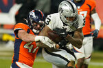 Denver Broncos inside linebacker Josey Jewell (47) tackles Las Vegas Raiders tight end Darren Waller (83) during the second half of an NFL football game, Sunday, Jan. 3, 2021, in Denver. (AP Photo/Jack Dempsey)