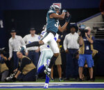 FILE - In this Dec. 9, 2018, file photo, Philadelphia Eagles cornerback Rasul Douglas (32) intercepts a pass by Dallas Cowboys quarterback Dak Prescott during the first half of an NFL football game, in Arlington, Texas. When injuries ravaged the secondary, the Eagles turned to inexperienced guys and castoffs. The no-names are making themselves known. (AP Photo/Michael Ainsworth, File)