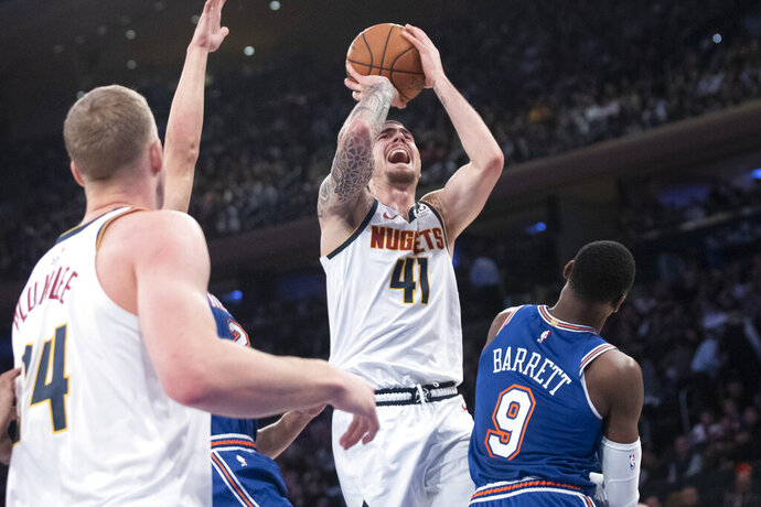 Denver Nuggets forward Juan Hernangomez (41) goes to the basket past New York Knicks forward RJ Barrett (9) during the first half of an NBA basketball game Thursday, Dec. 5, 2019, at Madison Square Garden in New York. (AP Photo/Mary Altaffer)