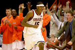 FILE - In this Nov. 24, 2002, file photo, Syracuse's Carmelo Anthony celebrates a three-point basket against Valparaiso during the second half of an NCAA college basketball game in Syracuse, N.Y. Anthony averaged 22.2 points and 10 rebounds per game to earn second-team Associated Press All-America honors while helping Syracuse win its first national title. Anthony Davis and Carmelo Anthony top our list of the best one-and-done players in college basketball history. (AP Photo/Kevin Rivoli, File)