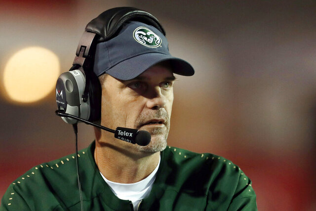 FILE - In this Oct. 11, 2019, file photo, Colorado State coach Mike Bobo watches from the sideline during the second half of an NCAA college football game against New Mexico in Albuquerque, N.M. First-year South Carolina assistant Mike Bobo said Thursday, Aug. 20, 2020, he was offended by allegations that anyone on his former Colorado State staff or team say they were abused or treated with racial insensitivity. Bobo had been Colorado State's coach the past five years before getting hired at South Carolina last December.  (AP Photo/Andres Leighton, File)