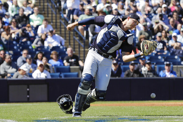 Detroit Tigers catcher Grayson Greiner loses control of a foul tip by New York Yankees' Gary Sanchez during the second inning of a spring training baseball game Saturday, Feb. 29, 2020, in Tampa, Fla.. (AP Photo/Frank Franklin II)