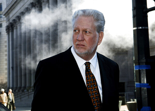 FILE - In this Jan. 30, 2006, file photo former Worldcom CEO Bernard Ebbers exits Manhattan federal court in New York. Ebbers, the former top executive sentenced to 25 years in prison in one of the largest corporate accounting scandals in U.S. history was ordered freed from prison Wednesday, Dec. 18, 2019, for medical reasons. (AP Photo/ Louis Lanzano, File)
