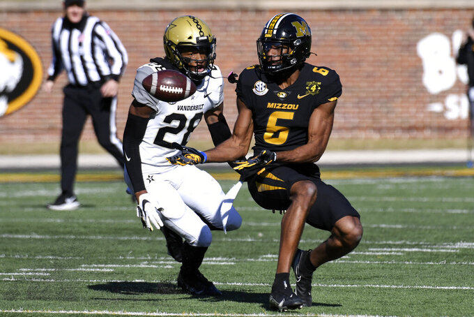 Missouri wide receiver Keke Chism (6) catches a pass as Vanderbilt cornerback Allan George (28) defends during the first half of an NCAA college football game Saturday, Nov. 28, 2020, in Columbia, Mo. (AP Photo/L.G. Patterson)