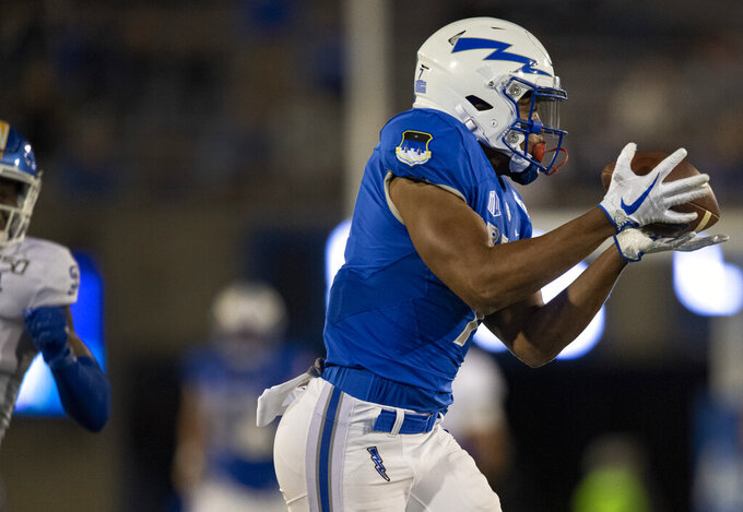 Air Force wide receiver Geraud Sanders (7) catches a throw from quarterback Donald Hammond III (5) for a 64-yard touchdown against San Jose State during the second quarter of an NCAA college football game, Friday, Sept. 27, 2019, at Air Force Academy, Colo. (Christian Murdock/The Gazette via AP)