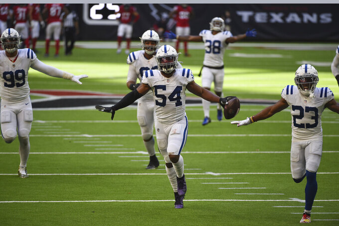 Indianapolis Colts middle linebacker Anthony Walker (54) celebrates with teammates after he recovered a fumble by Houston Texans quarterback Deshaun Watson during the second half of an NFL football game Sunday, Dec. 6, 2020, in Houston. (AP Photo/Eric Christian Smith)