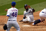 Miami Marlins' Lewin Diaz scores in front of New York Mets pitcher Jacob deGrom (48) during the sixth inning of a baseball game on Monday, Aug. 31, 2020, in New York. (AP Photo/Adam Hunger)