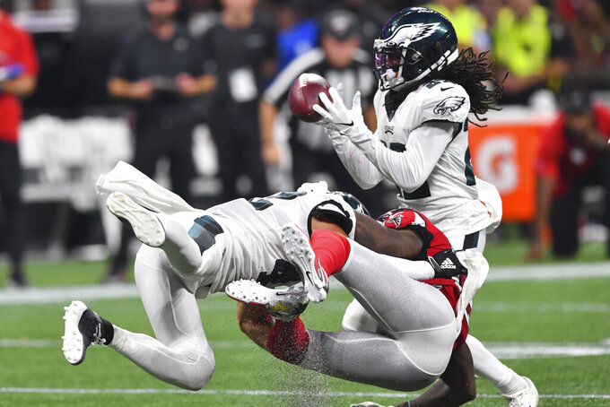 Philadelphia Eagles cornerback Sidney Jones (22) intercepts the ball from Atlanta Falcons wide receiver Mohamed Sanu (12) during the first half of an NFL football game, Sunday, Sept. 15, 2019, in Atlanta. (AP Photo/John Amis)