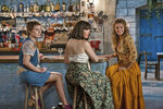 This image released by Universal Pictures shows Alexa Davies, from left, Jessica Keenan Wynn and Lily James in a scene from