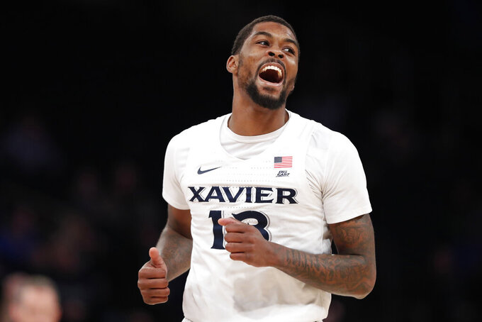 Xavier forward Naji Marshall reacts after tying the score during the second half of the team's NCAA college basketball game against DePaul in the first round of the Big East men's tournament Wednesday, March 11, 2020, in New York. DePaul won Xavier 71–67. (AP Photo/Kathy Willens)